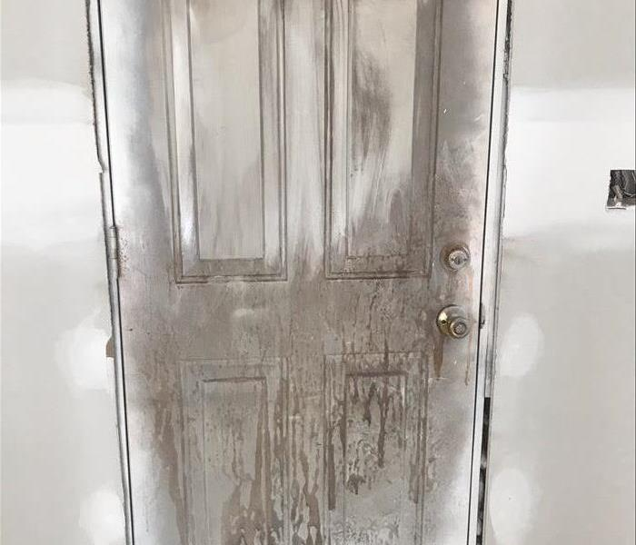 Fire Damage Repaired to a Door in St. Joseph, MO Before
